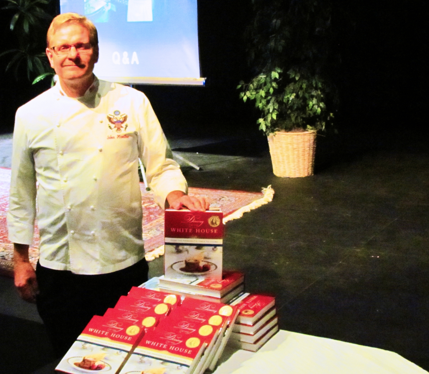White House Chef Moeller in front of his book